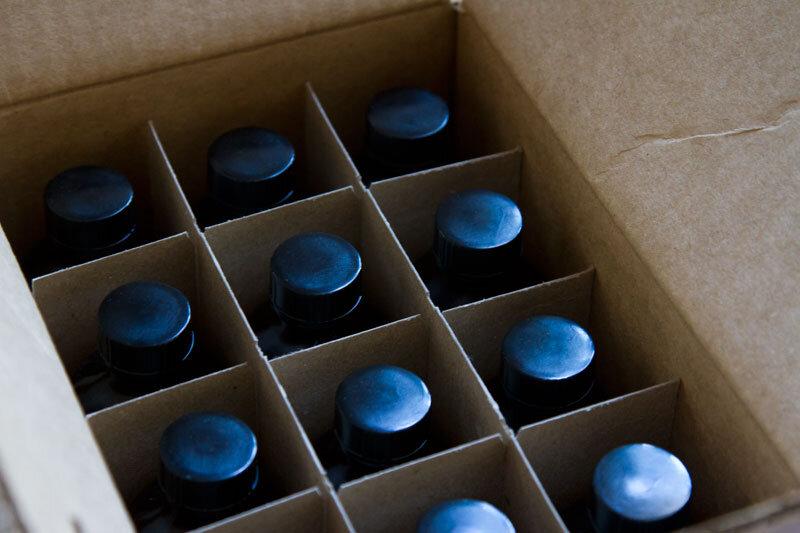 box of bottles reading my tea leaves