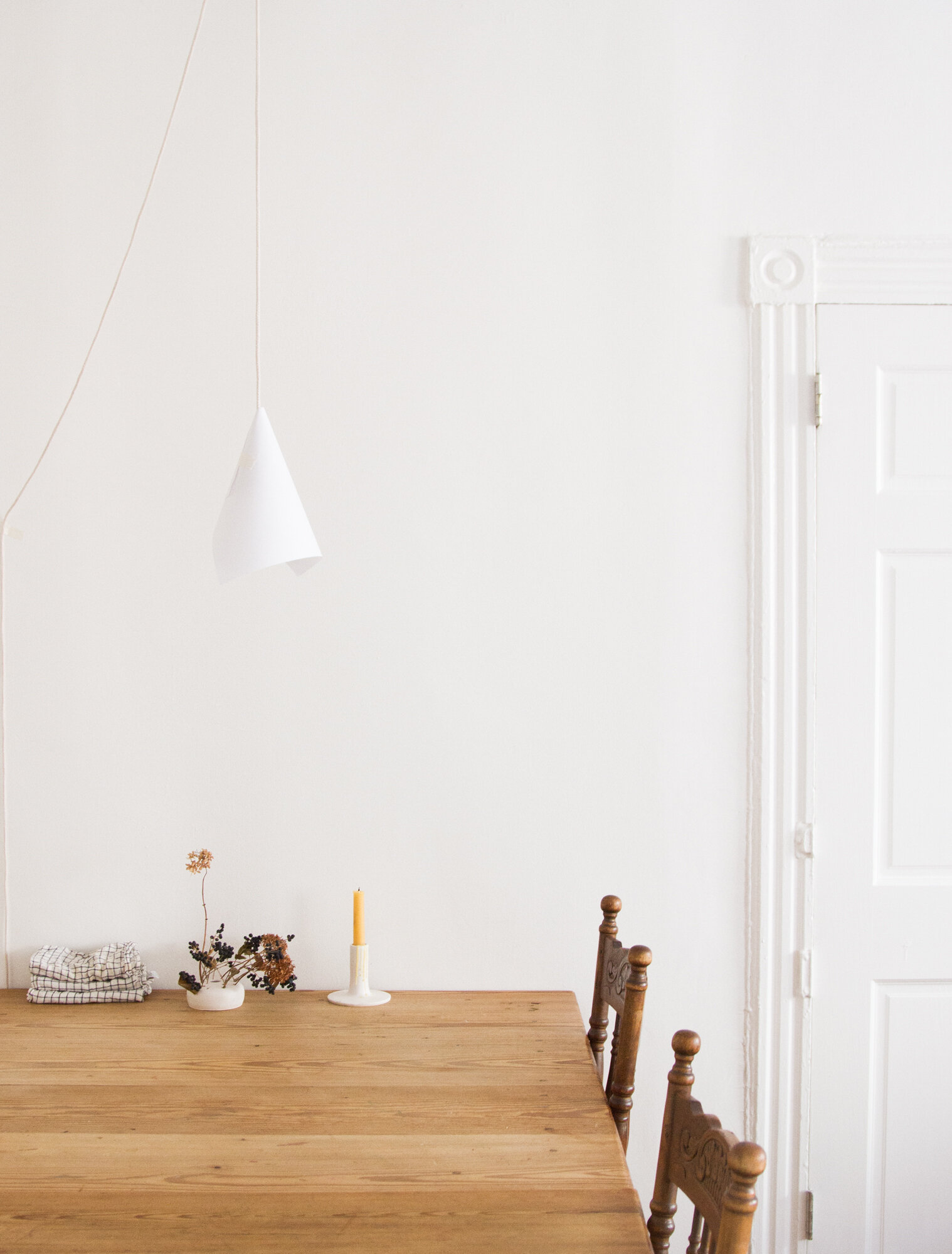 a paper and string lamp above a wooden table   reading my tea leaves